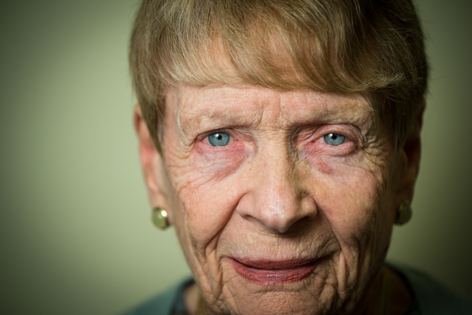 Portrait of elderly woman staring forward, with peaceful expression